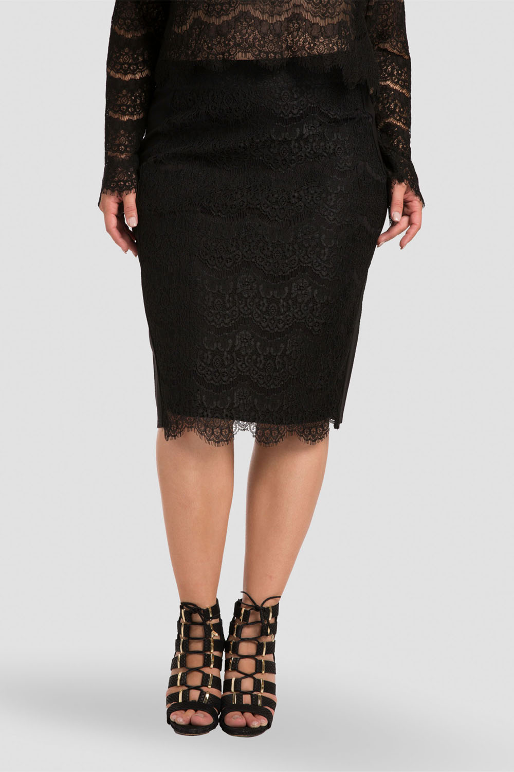 Plus size black ponte and knee-length pencil skirt