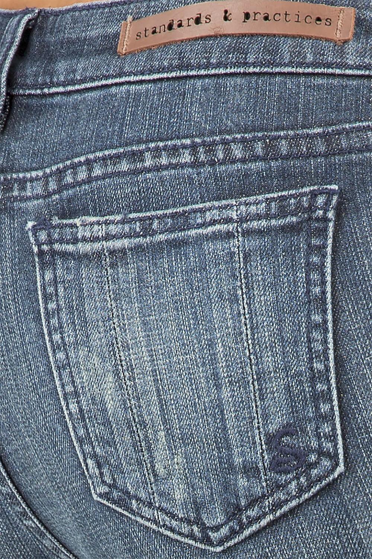 Women Blue Wash Denim Bootcut Jeans with Raw Released Hem